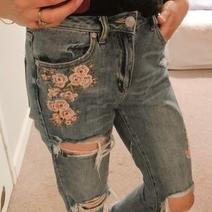 Distressed and embroidered denim